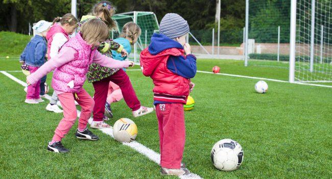 Kids shooting on football station